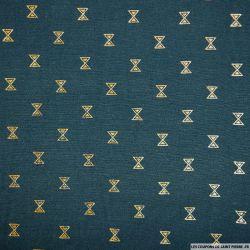 Polycoton imprimé sablier doré fond bleu canard