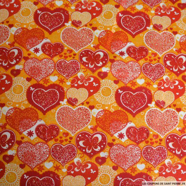 Coton imprimé coeur de noël orange et rouge