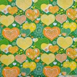 Coton imprimé coeur de noël vert et jaune