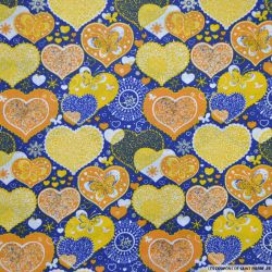 Coton imprimé coeur de noël orange et bleu