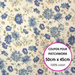 Coton imprimé fleurs bleues sur fond écru Coupon 50x45cm