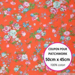 Coton imprimé fleurs crème rose et bleu sur fond orange Coupon 50x45cm