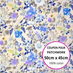 Coton imprimé fleurs bleues et mauves sur fond écru Coupon 50x45cm