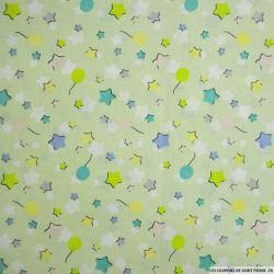Coton imprimé ballons et étoiles fond vert