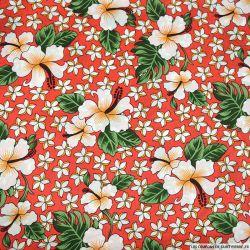 Satin polyester imprimé Hawaï fond corail