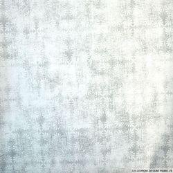 Piqué de coton géométrique noir sur fond blanc cassé