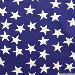 Gabardine de coton élasthane imprimé étoiles fond bleu