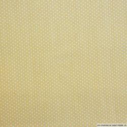 Coton imprimé petits pois blanc cassé fond beige