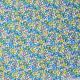 Coton imprimé petites fleurs bleues fond blanc cassé