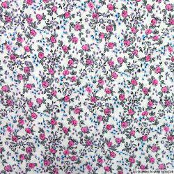 Coton imprimé fleurs rose et bleu sur fond blanc