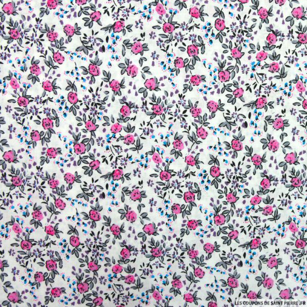 Coton imprimé fleurs roses et bleues sur fond blanc