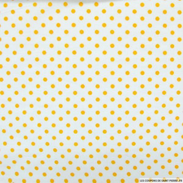 Coton imprimé pois 5 mm orange fond blanc cassé