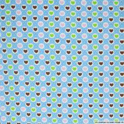 Coton imprimé coeurs fond bleu