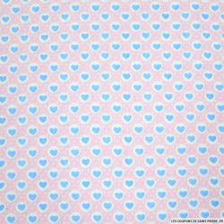Coton imprimé coeurs fond rose