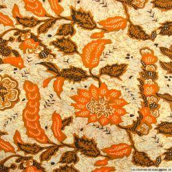 Polycoton imprimé fleurs et oiseau orange et caramel
