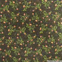 Polycoton imprimé fleurs corail fond noir