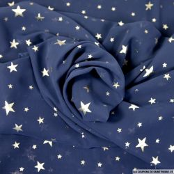 Mousseline polyester star argent fond marine