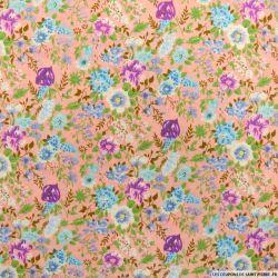 Coton imprimé fleurs violettes fond rose