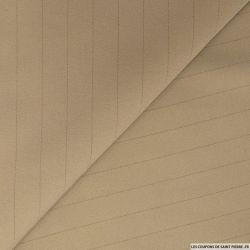 Crêpe polyester beige mojave pointillés