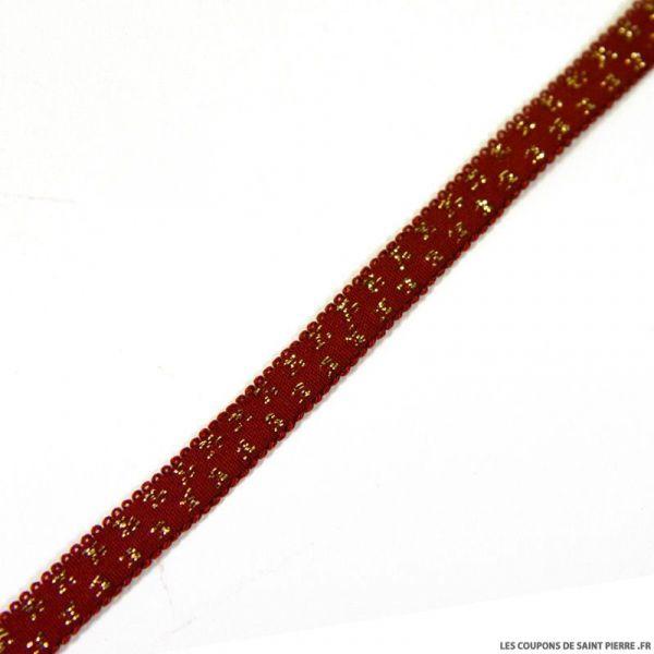 Elastique étoiles dorées fond bordeaux - 9 mm  au mètre