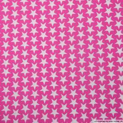 Coton imprimé étoiles fond rose