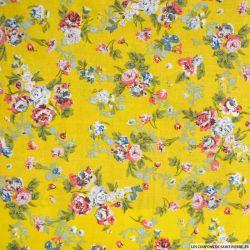 Coton imprimé fleurs rose sur fond jaune