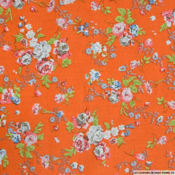 Coton imprimé fleurs roses sur fond orange