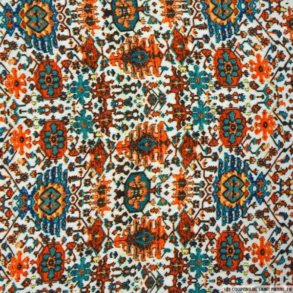 Crêpe viscose imprimé motif aztèque fond orange et vert