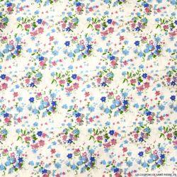 Coton imprimé fleurs sauvages bleu fond blanc