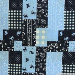 Coton imprimé patchwork cerf fond bleu