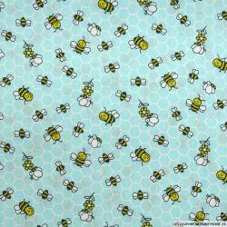 Coton imprimé ruches fond turquoise