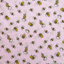 Coton imprimé ruches fond rose