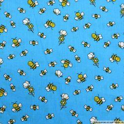 Coton imprimé abeilles fond bleu