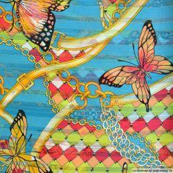 Mousseline dévorée rayures dorés papillons fond turquoise