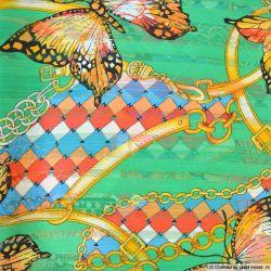 Mousseline dévorée rayures dorés papillons fond vert