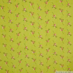 Coton imprimé branches fond vert
