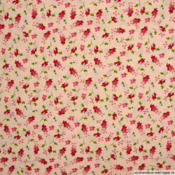 Coton imprimé botanique fond rose pâle