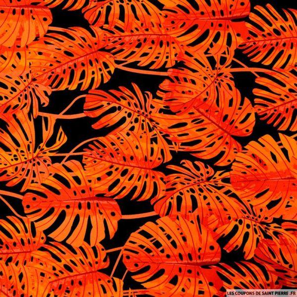 Satin de coton élasthane imprimé monstera orange fond noir