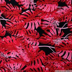 Satin de coton élasthane imprimé monstera rose fond noir