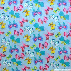 Coton imprimé papillon multicolore fond bleu