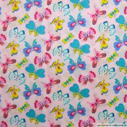 Coton imprimé papillon multicolore fond rose