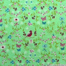 Coton imprimé oiseau sur la branche fond rose