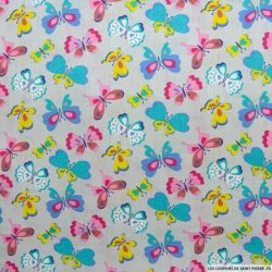 Coton imprimé papillon multicolore fond gris