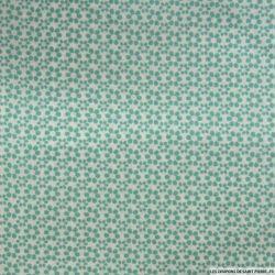 Coton imprimé 6 pétales vert de gris fond blanc