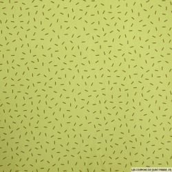 Piqué de coton imprimé feux d'artifice marron fond vert anis