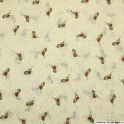 Mousseline polyester tulipe fond crème plumetis irisé