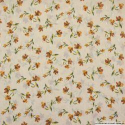 Mousseline polyester orchidée fond crème plumetis irisé