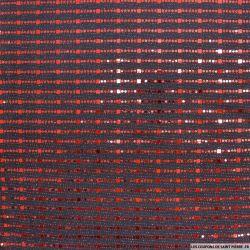 Jersey polyester pailleté geométrique rouge fond noir