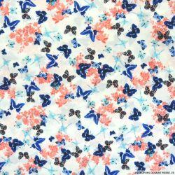 Crêpe polyester imprimé papillon fond blanc