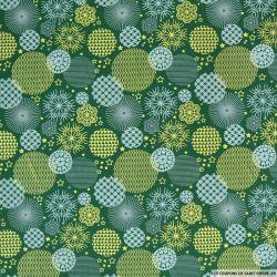 Coton imprimé boules de neiges fond vert sapin